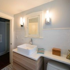 Marble hex tile, blue penny round tile, sconce lighting, quartz countertop, banjo countertop, sconce lighting, subway tile wainscot, vessel sink, Ikea vanity, wall mounted vanity