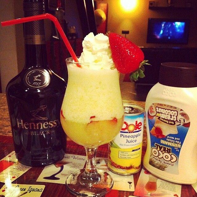 BLACK HENNY COLADA  2 oz. (60ml) Black Hennessy  4 oz. (120ml) Pineapple Juice 2 oz. (60ml) Cream of Coconut Ice Blend Strawberries to garnish