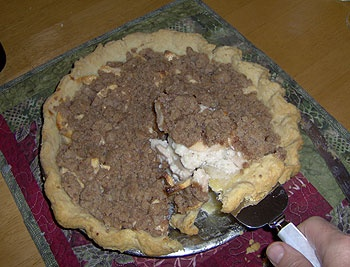 Sour cream apple pie with a streusel topping.