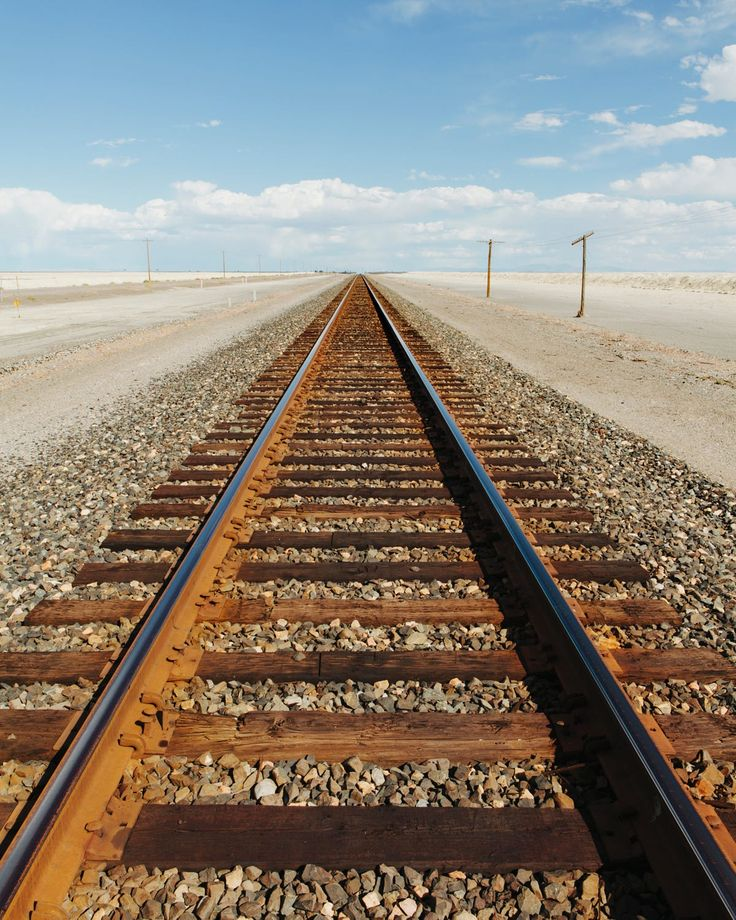 A railroad extending through the desert, near Wendover in Utah.  by Mint Images on 500px