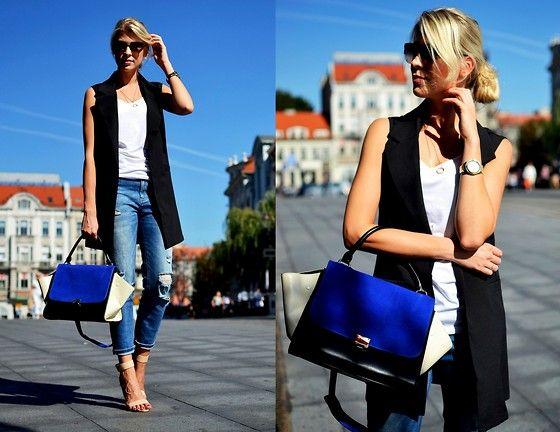 white tank, black long vest, distressed denim, heels                                                                                                                                                                                 More