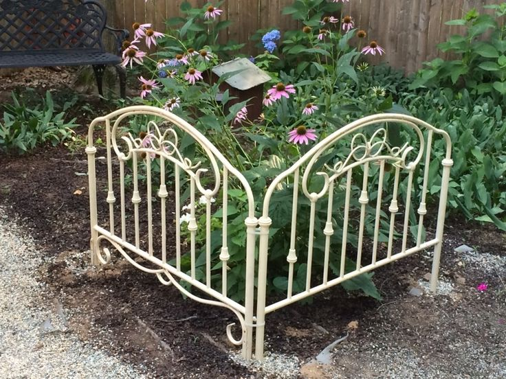 Re-purpose an old iron twin bed into a beautiful garden fence...