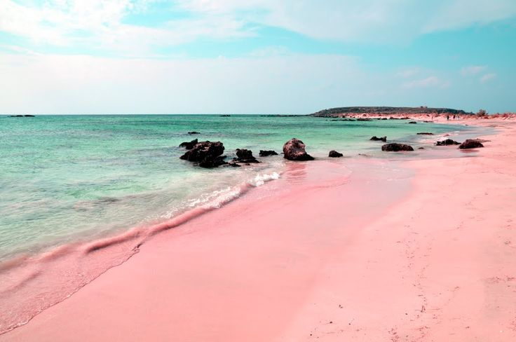 passivites:Eroded particles from red corals has given this beaches sand a pinkish glow.