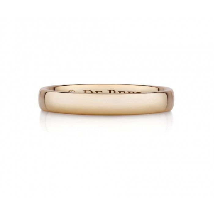 Pink Gold Wide Court Band his classic 3mm pink gold wedding band has a sparkling diamond discretely positioned on the inside of the ring.