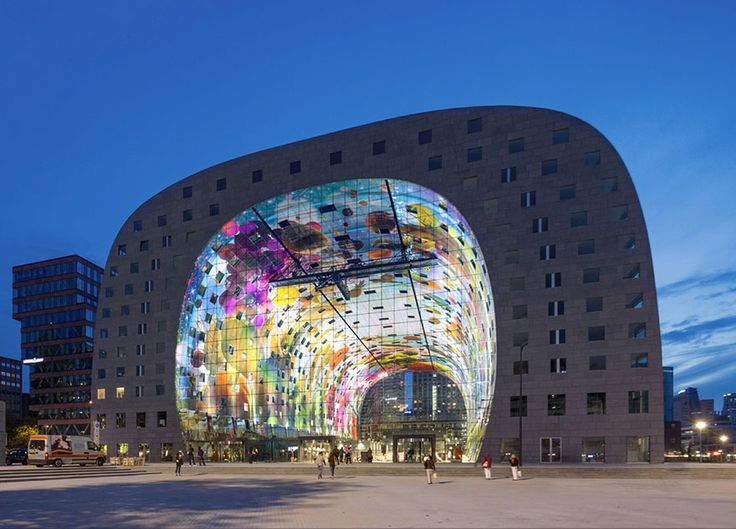 "Rotterdam. The enormous mural, by artists Arno Coenen and Iris Roskam, is titled ""Cornucopia."" It features brightly colored fruits, vegetables, and other market goods ascending into the sky like the ceiling mural of a cathedral."