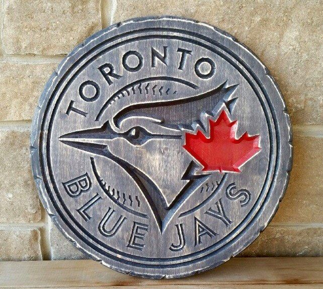 A personal favorite from my Etsy shop https://www.etsy.com/ca/listing/290651377/toronto-blue-jays-wood-carved-sign