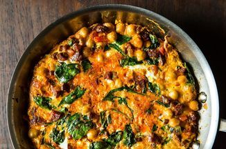 Dense, fresh and robustly spiced, this is one of my favourite fritattas. The nutty bite of chickpeas rolled around in the orange oil oozing from the chorizo give the dish a substantial feel, making it good for a full meal not a just side dish. I've made it with spinach, chard and cavalo nero, play around with the flavours, it is very forgiving.
