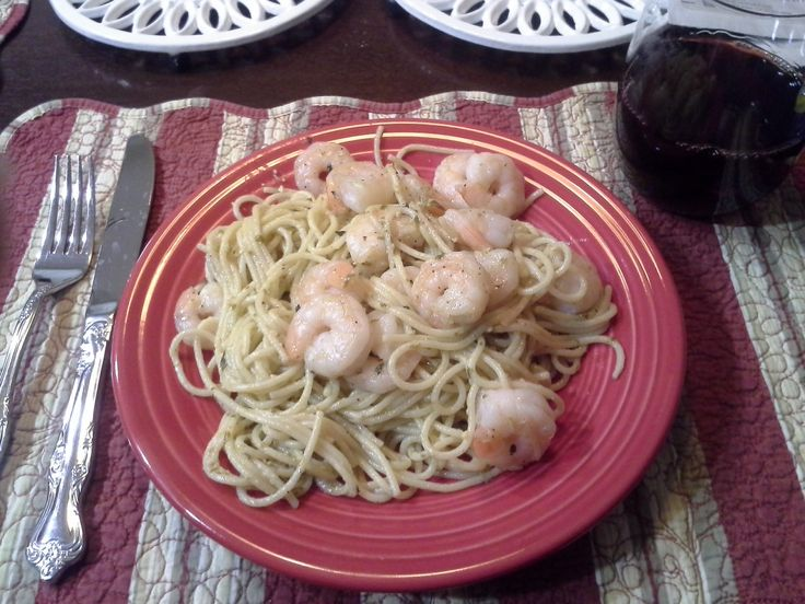 1/2 pack of spaghetti noddles  1/2 jar Trader Joes pesto sauce Garlic Olive oil Butter 1lb large shrimp  Cook the noddles aldente  Drain and mix in the pesto Sauté the shrimp in butter, little peppe, little Basil, no salt. Serve up and place the shrimp on top, man food and so easy,  A man could do it. Do it when your wife is not feeling well and you will be a hero!