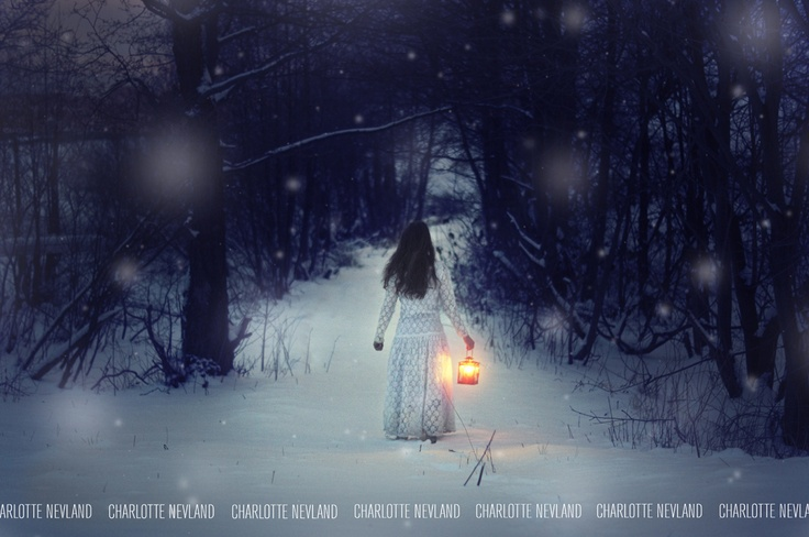 A girl alone in the woods, with just one light source.
