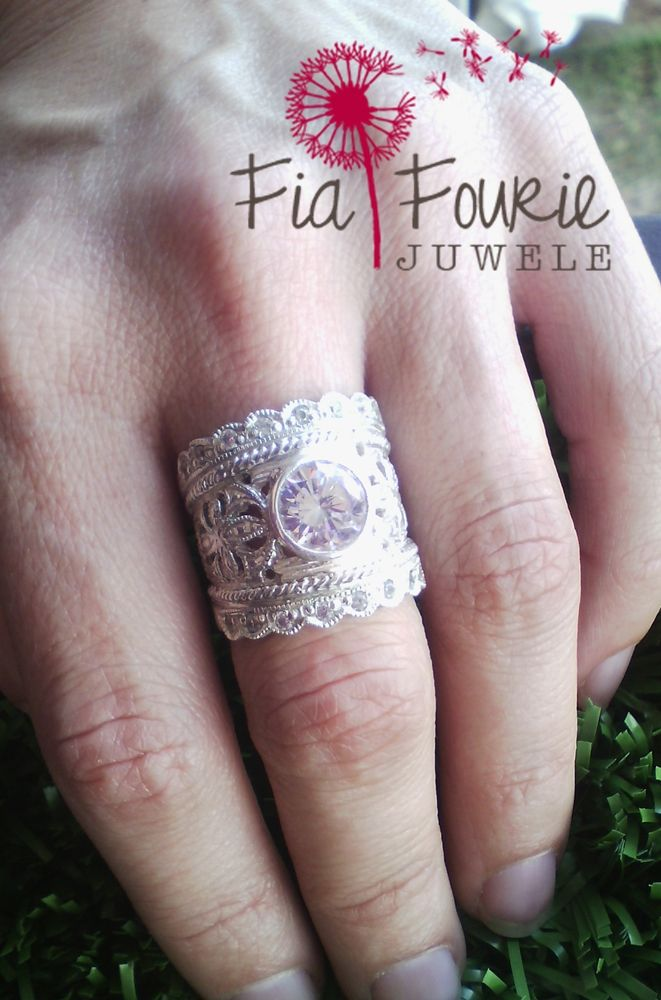 This classic feminine ring with it's spectacular lace-like detail and shimmering stones will definitely turn heads!