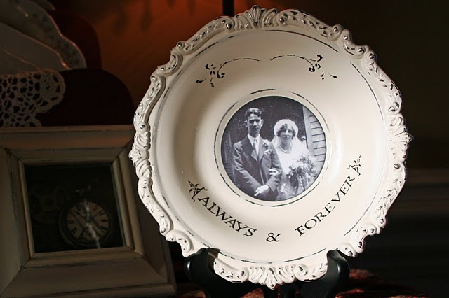 silver plated bowls. I love this to display old pictures. It melts my heart, especially because I think of my grandparents wedding photos and how my gramma looked like a million bucks and so SaSsY!!