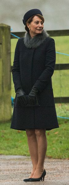 Carole Middleton wrapped up in a black wool coat with a fur collar, adding a pair of leather gloves and a small clutch bag, for the church service on Sunday morning, January 8, 2017 in King's Lynn, England