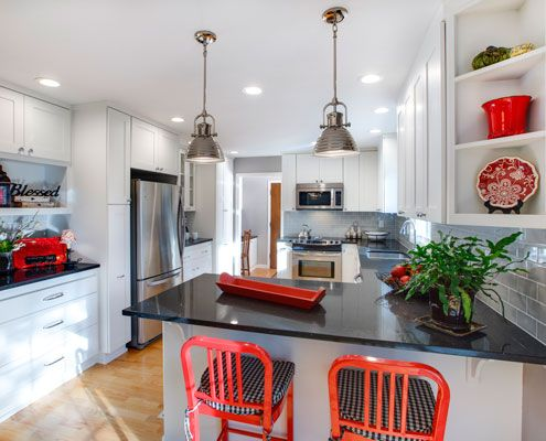 White Cabinetry, Gray Subway Tile and Belgium Moon Quartz Countertops with  pops of red accent