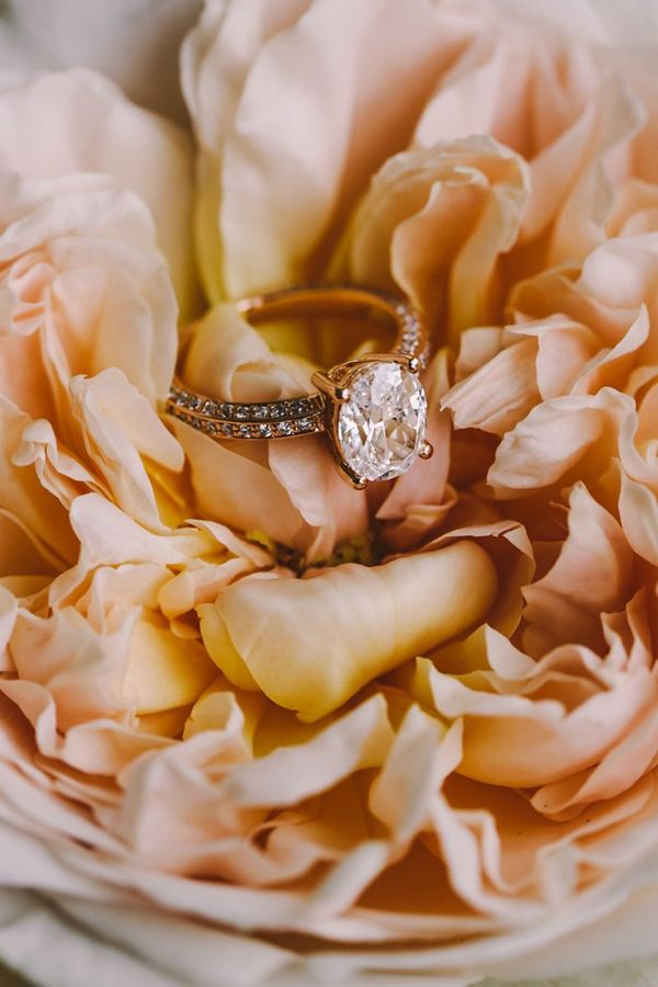 pavé engagement ring - photo by Lara Hotz http://ruffledblog.com/romantic-australian-wedding-in-a-library #engagementring #rings #jewelry