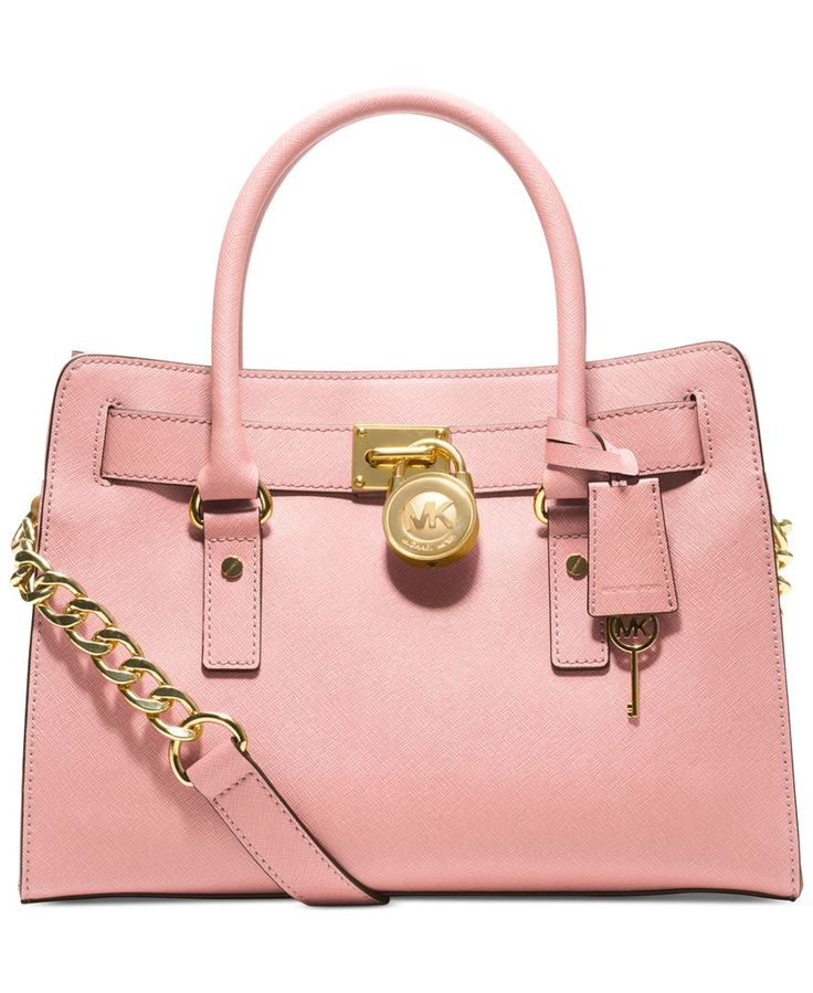 Soft leather and luxe hardware grace this gorgeous design from Michael Michael Kors. Bold chain detailing and a prominent signature lock charm at front perfectly accent this femme satchel silhouette.