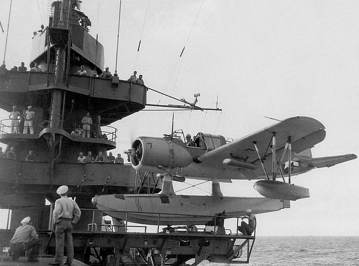 An OS2U Kingfisher scout plane is seen before launch atop the middle turret of USS Texas while at Iwo Jima, February 1945.