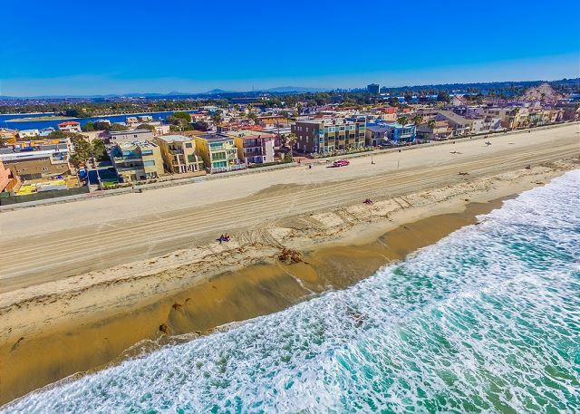 Looking for a ground floor ocean front home? This condo is perfect for a family vacation located directly on the Mission Beach boardwalk in San Diego, California. Great for surfing or paddling!