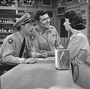 """THE ANDY GRIFFITH SHOW - Andy lives with his son Opie and his spinster housekeeper, Aunt """"Bee"""" Taylor. Episodes revolve around Andy's life as a lawman, a father, and a lover. The series was very popular from its inception, won Emmys for stars Don Knotts and Frances Bavier, and left the air when it was #1 in the Nielsen Ratings."""