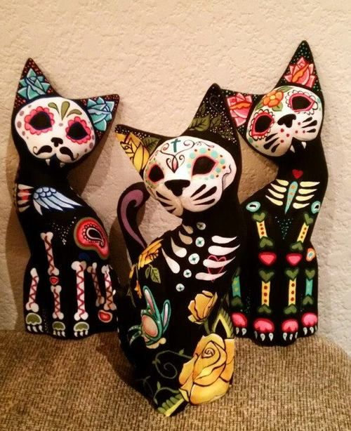 sugarcatskuls (could probably work with any animal sculpture, spray painted and hand customized)