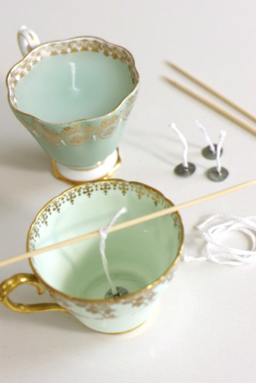 DIY teacup candles: Love these! So cute as a centerpiece on a tea party table or shower table. Perfect given as party favors too. Use mis-matched cups from a thrift store for a pretty, inexpensive shabby chic theme or gift.