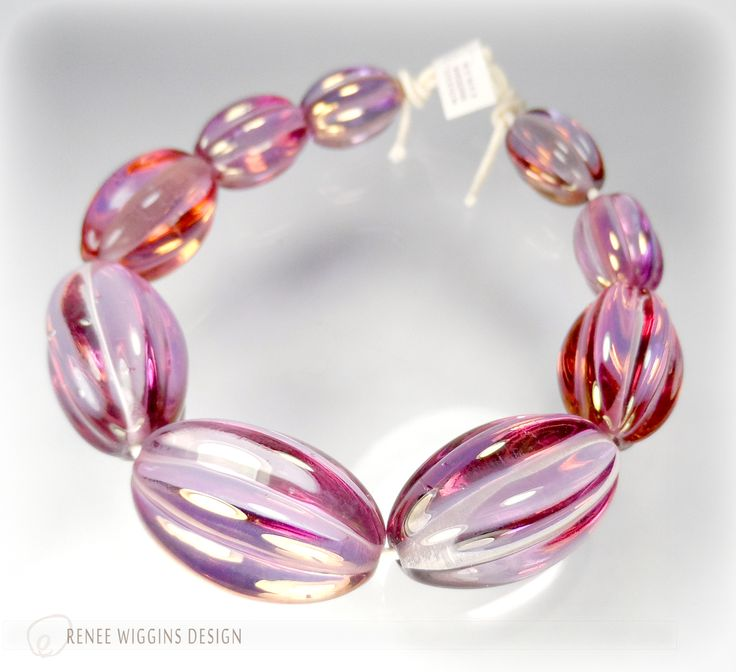 gold fumed graduated melon bead set of 9 beads are approx 58