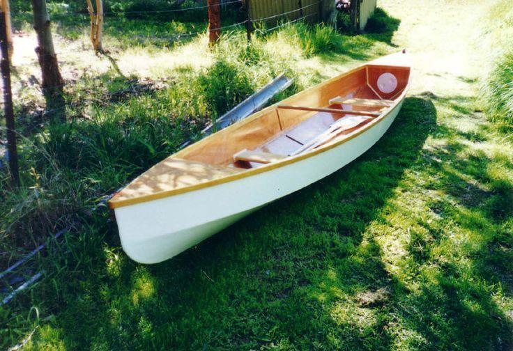 White Eureka stitch and glue lightweight canoe