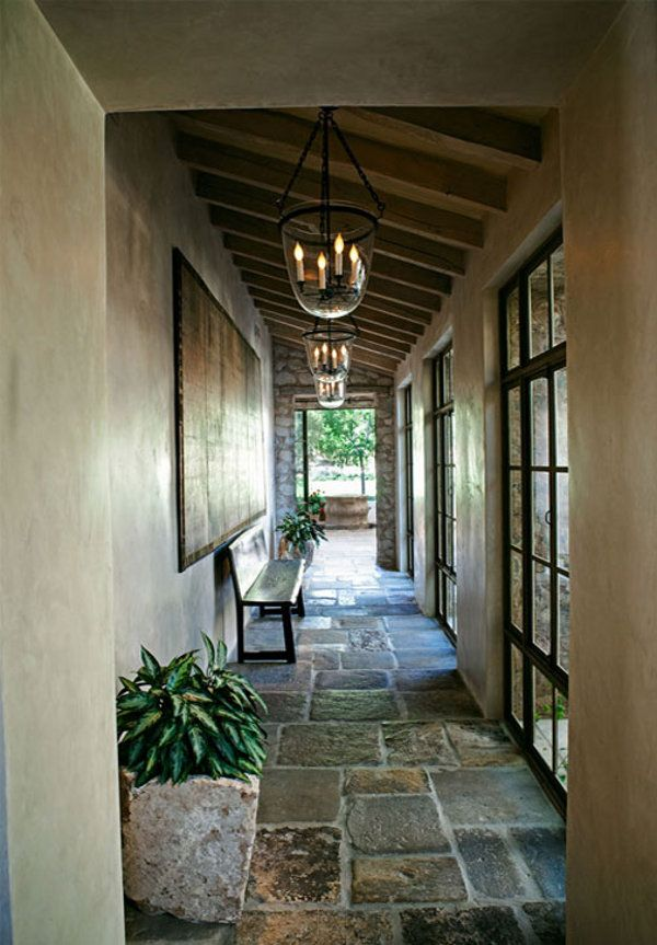Love this long loggia / hallway with its gorgeous stone floors and softly lite hanging lanterns in Arizona. From Dust Jacket.