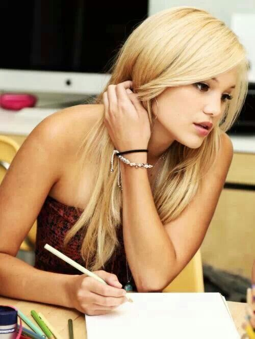 Olivia Holt. Wonder what she's drawing.