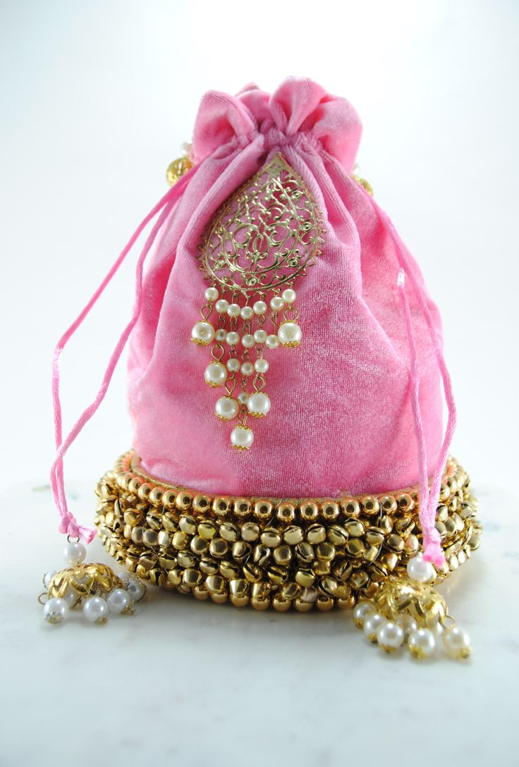 Baby pink wedding potli bag in velvet fabric. Base is made of gold metal beads, decorated with gold metal ambi motif and pearl drops. - Velvet - Baby Pink Colour - Imported DIMENSIONS Approx 9X6.5 inc