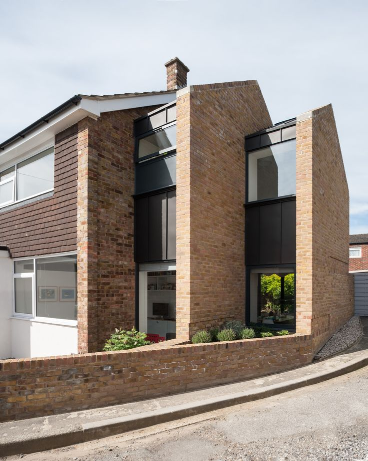Re-imagining a mid-century 1960's terraced house with 2 storey side extension with brick gable walls and zinc infill. By Selencky///Parsons. Photo by Andy Matthews