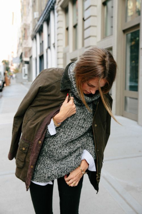 Wear a crisp button-up under a chunky cowl neck sweater. Balance out the…