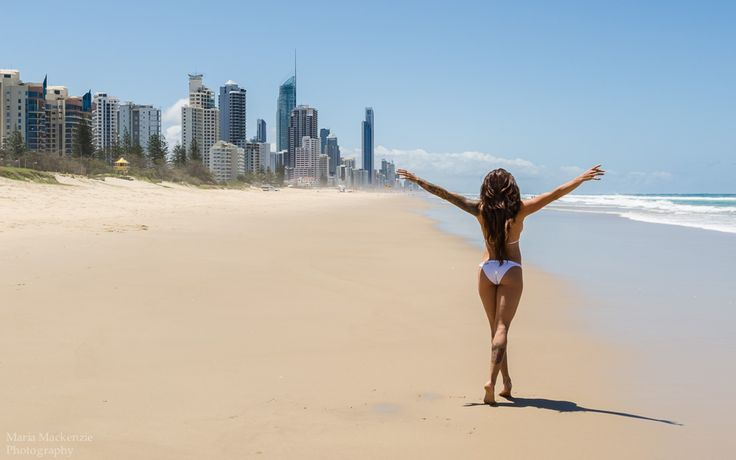 Enjoying the beautiful beach at Broadbeach with cityscape in distance.