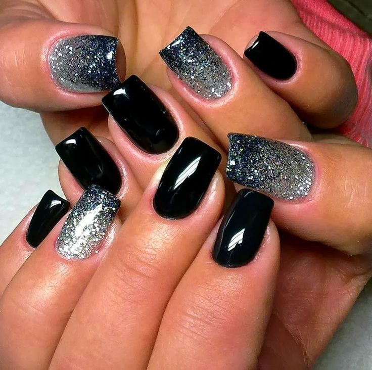 Ombre with glitter polish is always pretty. Looks as if they simply painted the nail with silver glitter first then started from the bottom using a black glitter,  & gently faded out the polish towards the top.