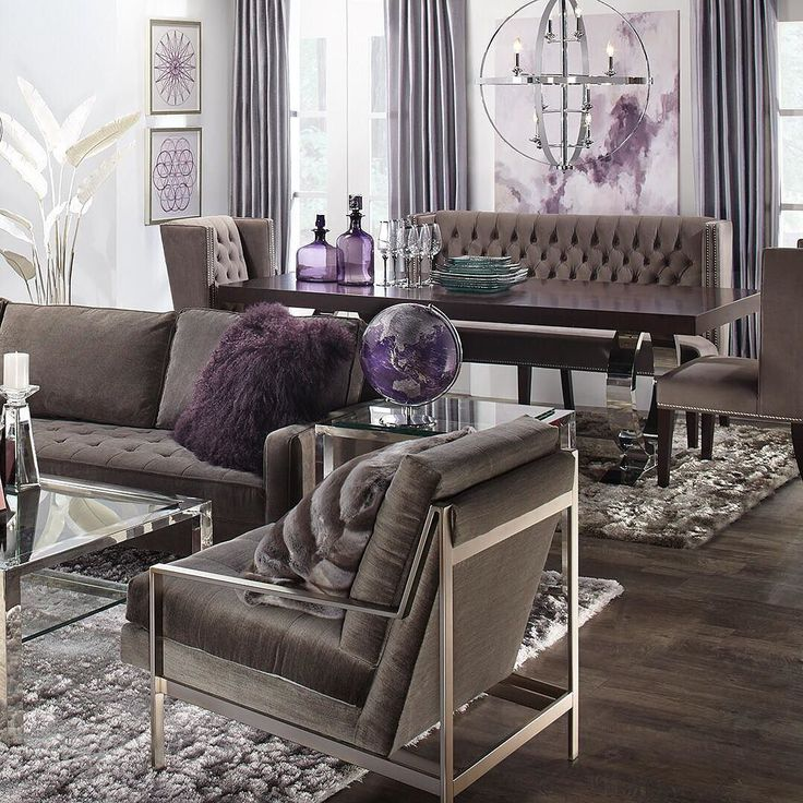 Sit and stay a while. Charcoal furniture makes a modern masterpiece of any room, take your open floor plan to modern maximalist heights! Link in bio to shop the look.