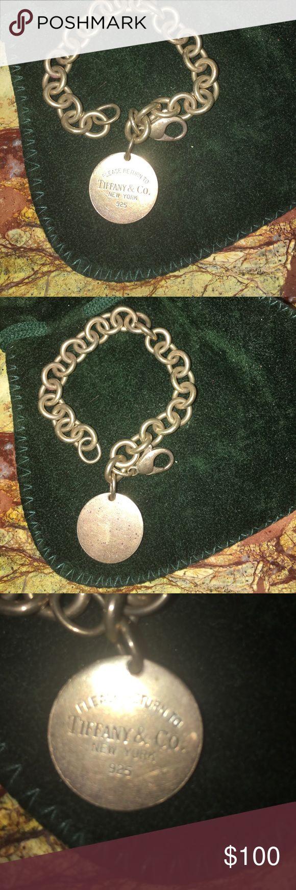 Tiffany round tag charm bracelet Tiffany round charm bracelet, used, silver needs cleaning. Tiffany & Co. Jewelry Bracelets