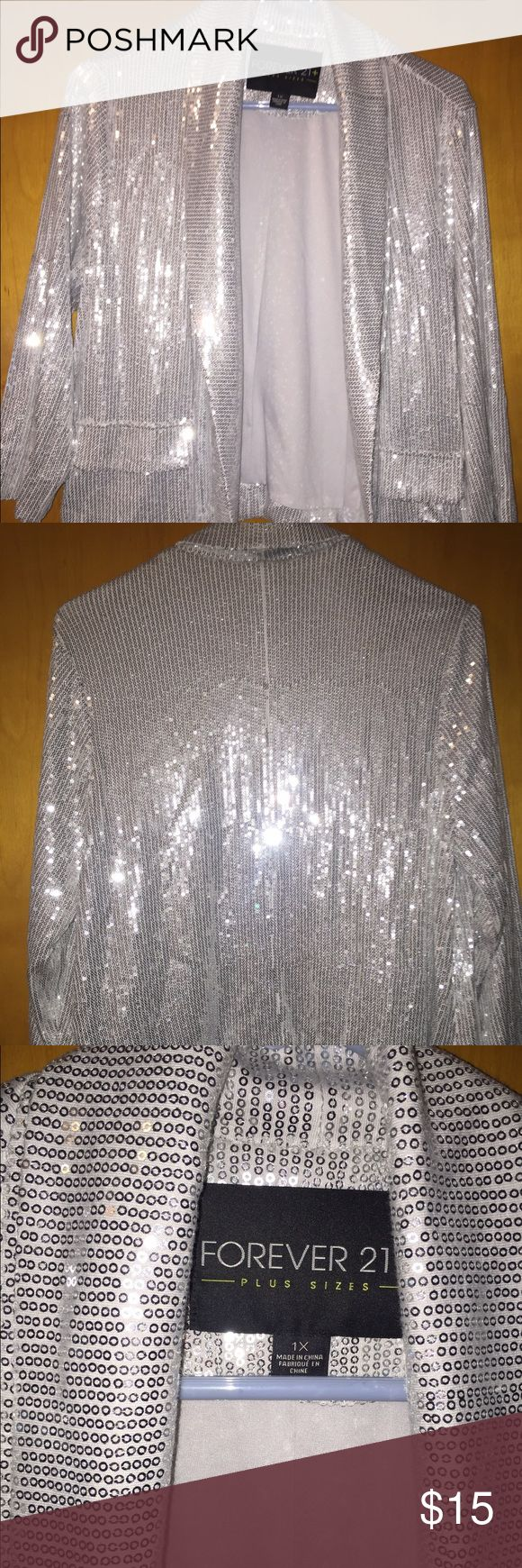 Forever 21 silver blazer Shiny and chic.. Silver shimmery blazer from forever 21 size 1x. Faux pockets. Great used condition. Pair with black jeggins, white tank top and sexy black heels and you're ready to go.. Forever 21 Jackets & Coats Blazers
