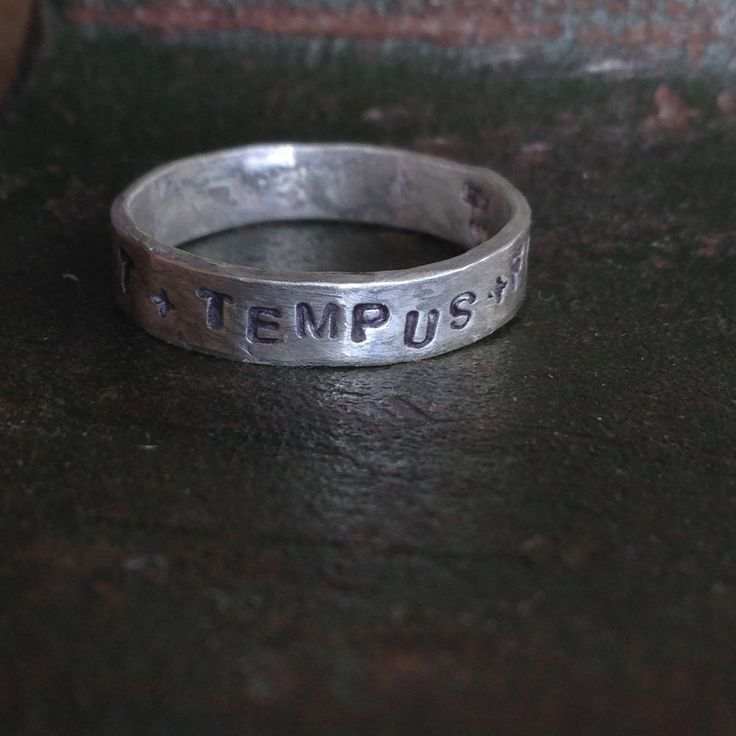 TEMPUS FUGIT AMOR MANET...  (time flies love remains)...  Solid sterling silver inscription message band ring by London Designer LAW...  Her pieces are inspired by ancient / medieval / antique / vintage / relics from long ago...  Bespoke pieces available x