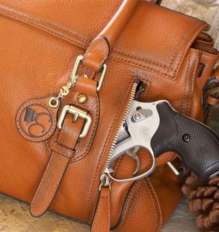 GunHandbags.com - online store that sells name brand, fashionable purses with compartments to safely hide a handgun or a taser, pepper spray or other self defense items.