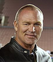 """Oklahoman Brian Keith Bosworth (born March 9, 1965 in OKC, OK.), nicknamed """"The Boz,"""" is a former American college and professional football player who was a linebacker in the National Football League (NFL) for three seasons during the 1980s. He played college football for the University of Oklahoma, and was a two-time consensus All-American. He played professionally for the NFL's Seattle Seahawks. He also was made famous by his flamboyant personality, radical hair cuts, and risky stunts."""
