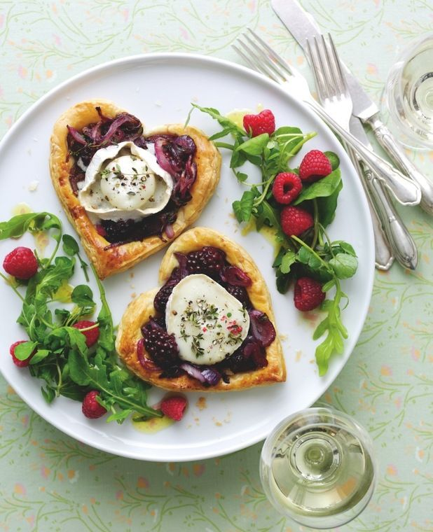 Heart-shaped Blackberry and Goat's Cheese Tart are topped with a combo of fruity blackberries and goat's cheese, they're a great dish to serve during a romantic meal for two.