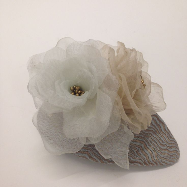 Organza silk flowers and tapestry fabric.