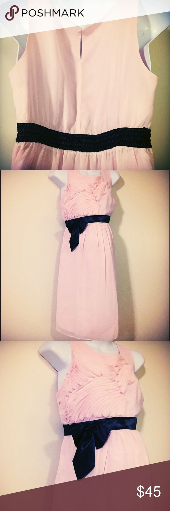 Formal pink maternity dress size large Excellent condition Gorgeous maternity dress size large by Pea in the pod. 100% polyester machine wash cold tumble dry low. Beautiful soft pink color with stretchy waist. Side zipper and satin layer underneath. Perfect for a baby shower or wedding! Price firm unless bundled. A Pea in the Pod Dresses