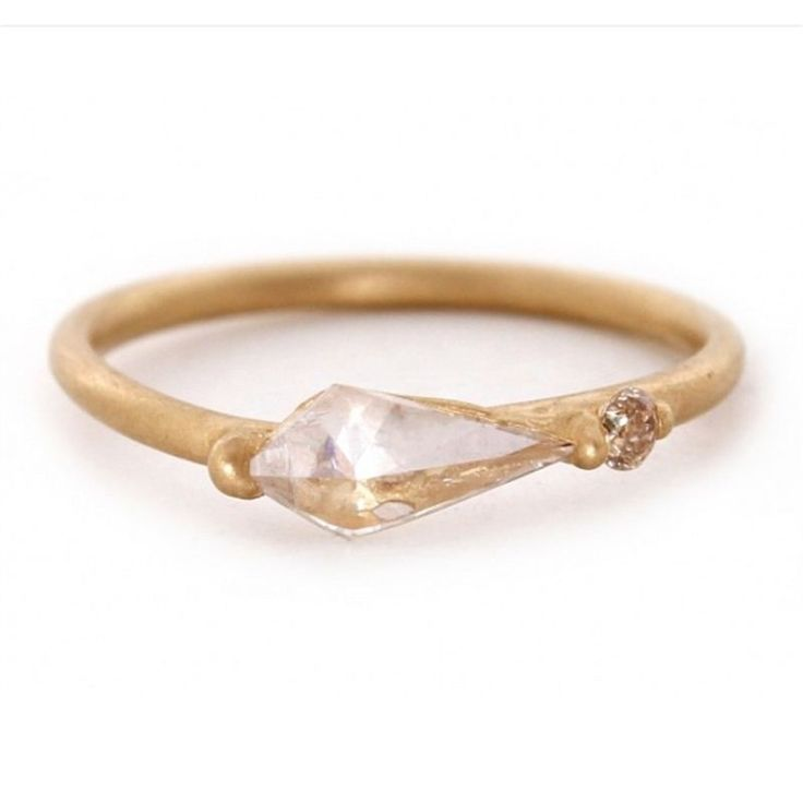Keep it simple.  How beautiful! This gold Halo ring by Polly Wales holds an unusual kite diamond that will stand out in any ring stack. As it is passed down it will carry with it all the happy memories of previous generations.