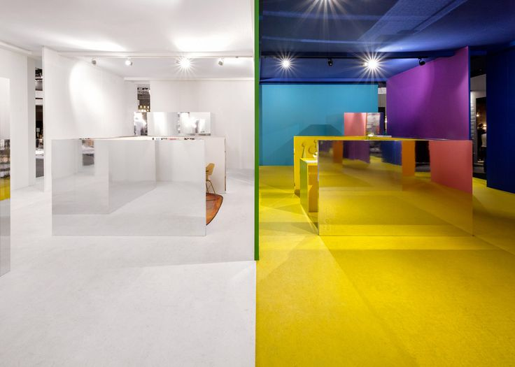Multicoloured walls and mirrored volumes used to create temporary exhibition space.