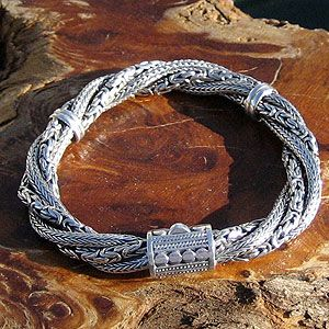 """""""Braided Twist"""" Bali Silver Bracelet  - Four separate chains make up this eye-catching and intriguing bracelet. Two 3mm Byzantine (Borobudur) and two 3mm Wheat (Bunga Padi) styles are braided with two Sterling keepers to maintain the design. You'll notice the sparkle on your wrist as the contrasting light and dark areas play off each other. The clasp, as usual, is gorgeously done in a combination of wire twist and traditional Bali dot work."""