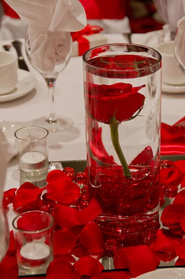 Submersed red rose centerpiece flamenco quinceanera