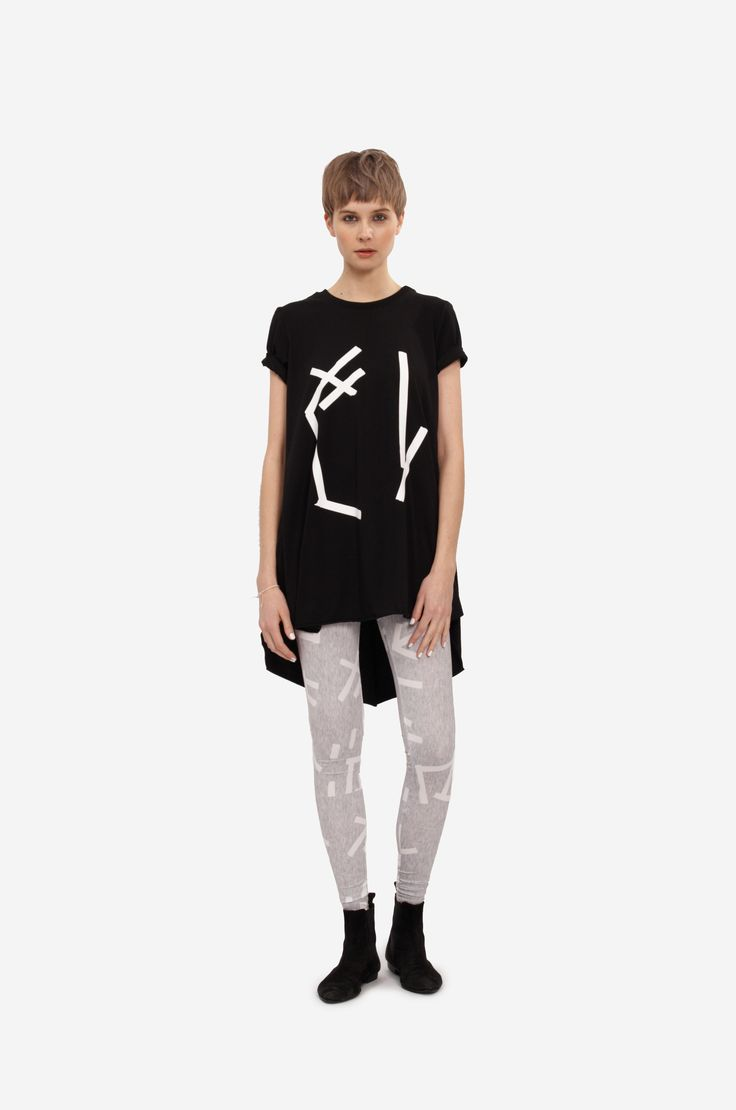 """DRESS """"ABSTRACT"""" Shorthaired model wearing an a-line dress with original print leggings."""