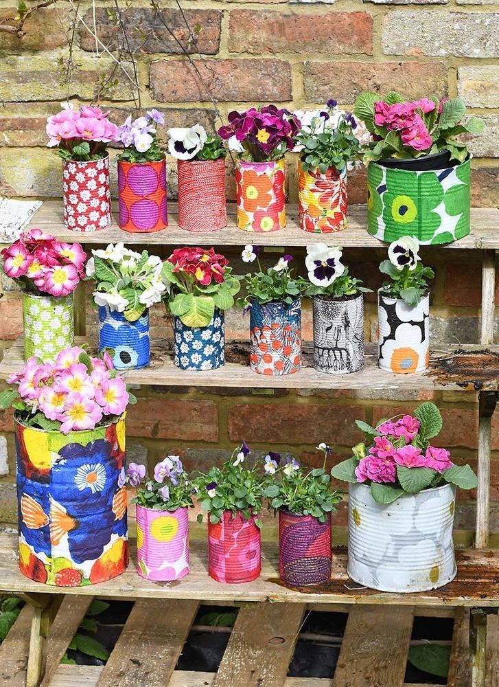 15 nice options, tin cans in planters for outdoor container gardens or