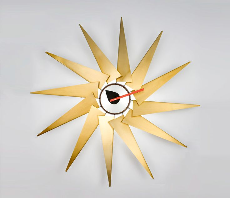 Designer: George Nelson, 1958  Description: The Turbine clock is a grand and beautiful modern wall clock and it is without question one of the most popular wall clocks ever made.