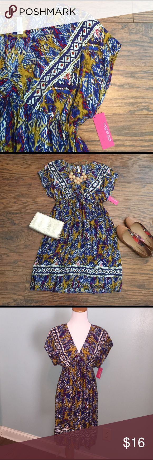 NWT!! Super cute tribal print dress Size medium. Super cute print, lightweight fabric. Perfect for a Spring day or a beach trip! Would also be perfect for a coverup! 100% rayon. Xhilaration Dresses Midi